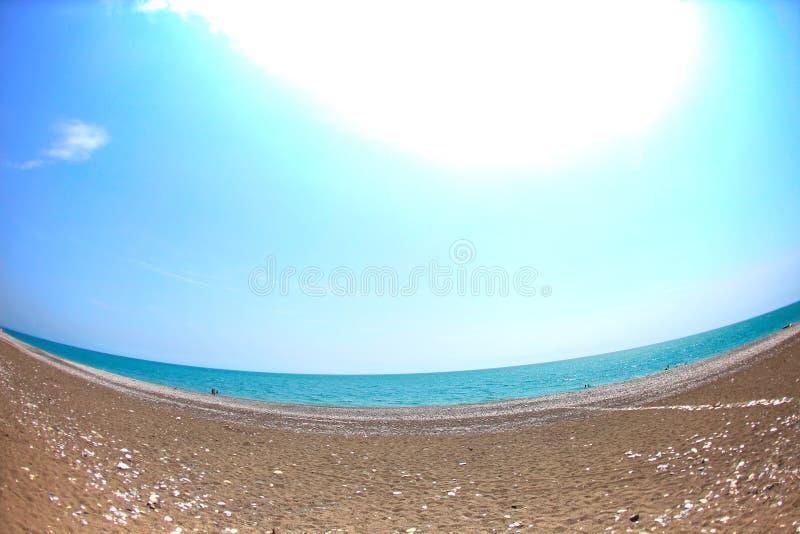 Shingle beach and blue sea. At an angle stock photo