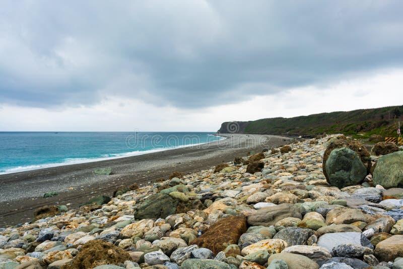 Shingle beach on pacific ocean coast in Qixingtan Scenic Area Hualien Taiwan royalty free stock images