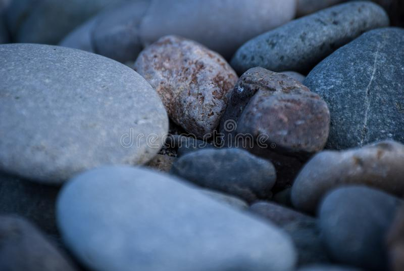 A shingle beach or beach stone. A shingle beach also referred to as rocky beach or pebble beach is a beach which is armoured with pebbles or small- to medium stock image