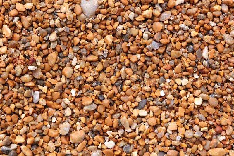 Shingle Beach Texture. Close up of wet shingle on a beach stock photos