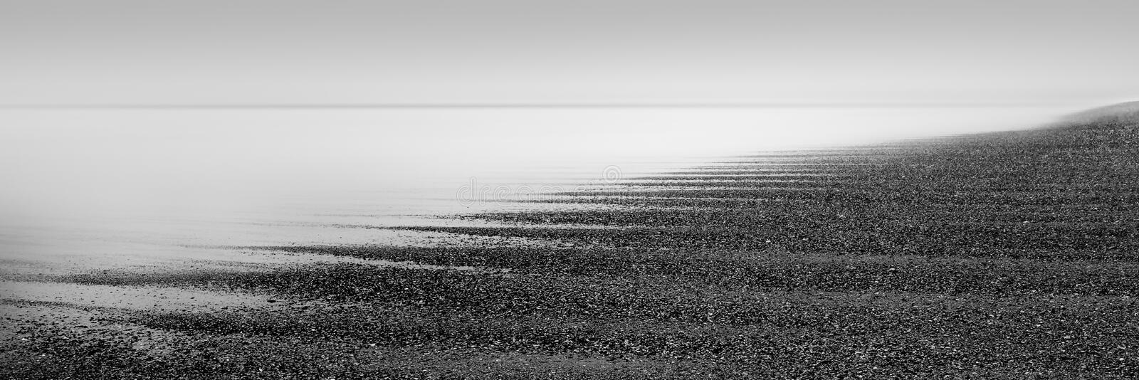 Shingle and Mist on Cornwall beach, UK. Shingle and Mist on North Cornwall beach, UK. High contrast photograph, captured in black and white royalty free stock photography