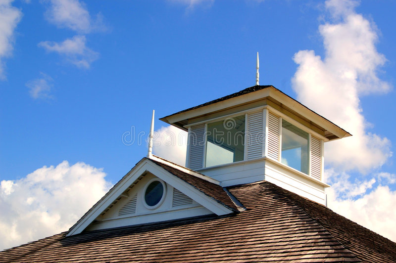 Shingle rooftop against a cloudy sky stock photography
