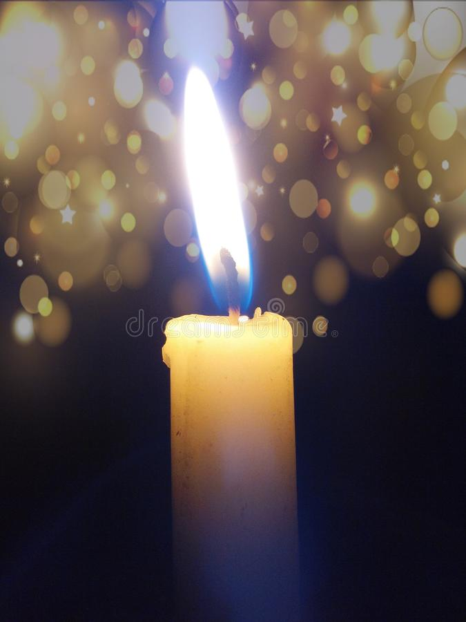 Shining Candle With Light Effects stock photo