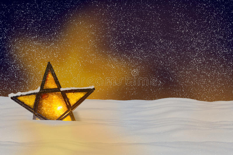 Shining Christmas star at night. In the snow stock images