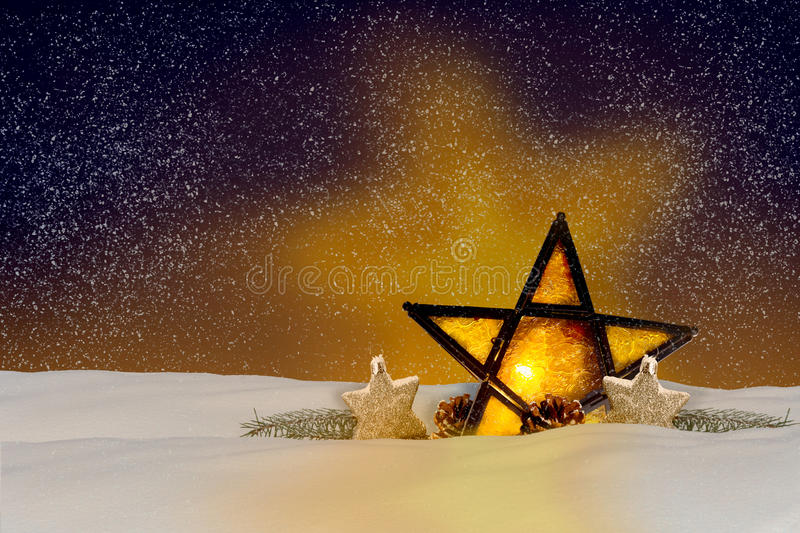 Shining Christmas star at night. In the snow royalty free stock photography