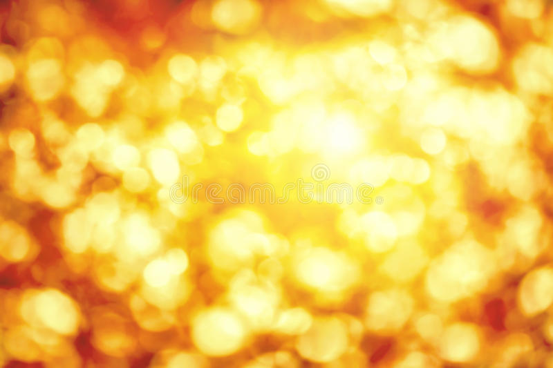 Shining defocused highlights in gold and yellow. Shining out-of-focus highlights in gold and yellow, a bright bokeh background ideal for autumn or Christmas stock images