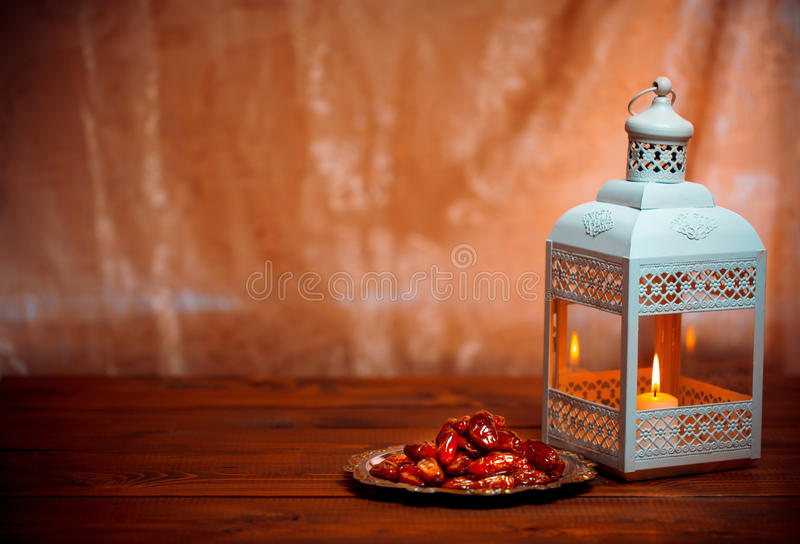 Shining Fanus lantern and dried dates royalty free stock photography