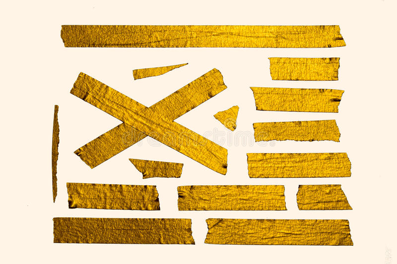 Shining Gold Tape Pieces. A collection of Home-Made Gold paper tape pieces stock photo