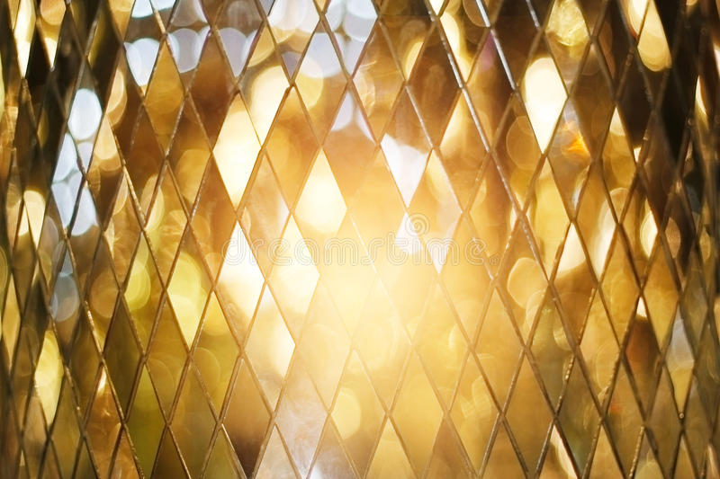 Shining golden mosaic glass background royalty free stock photos