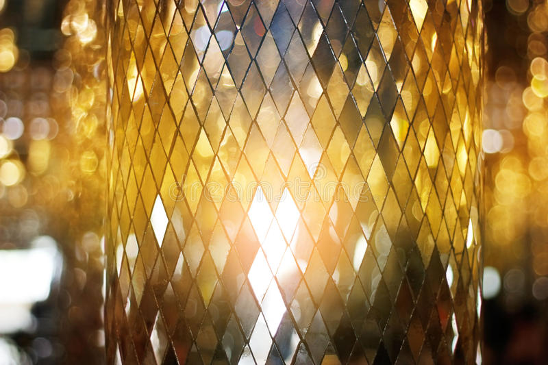 Shining golden mosaic glass texture background royalty free stock photography