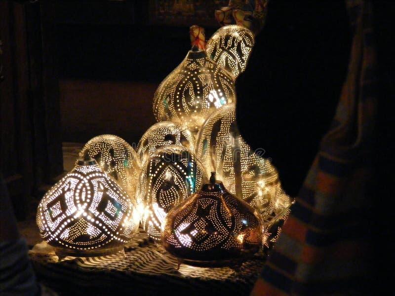 Shining lanterns in khan el khalili souq market with Arabic handwriting on it in egypt cairo stock photos