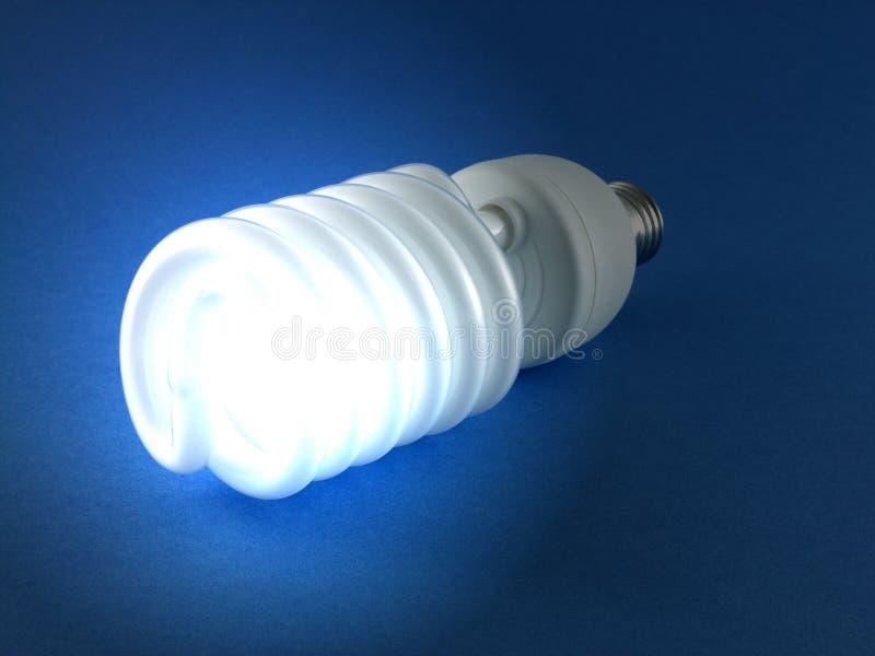 Shining light bulb. On the blue background stock images