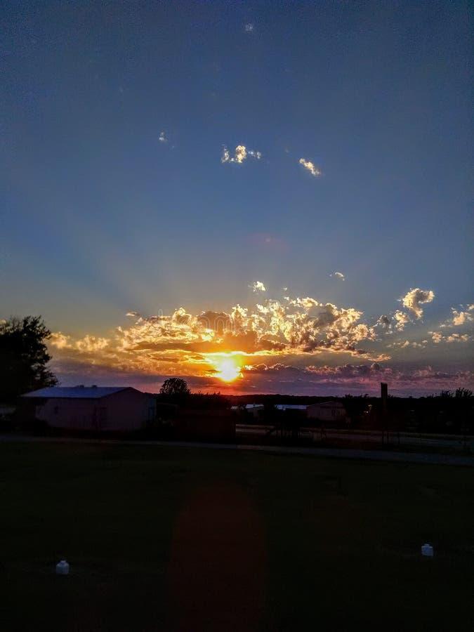 Shining Light. Crepuscular ray sunshine sunset clouds sky nature beauty light shining royalty free stock image