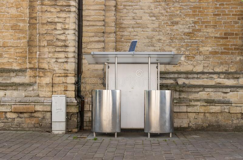 A shining public toilet with two urinals stock photo