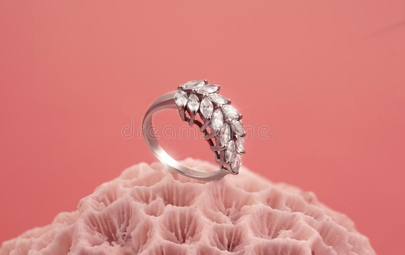 Shining ring on the Coral stone stock photos