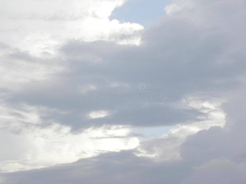 Shining white color and dark gray clouds royalty free stock images