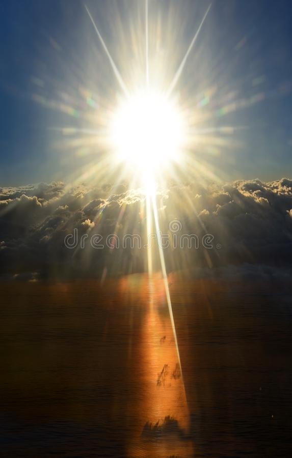 Shining sun above stormy clouds. Day & night. royalty free stock image