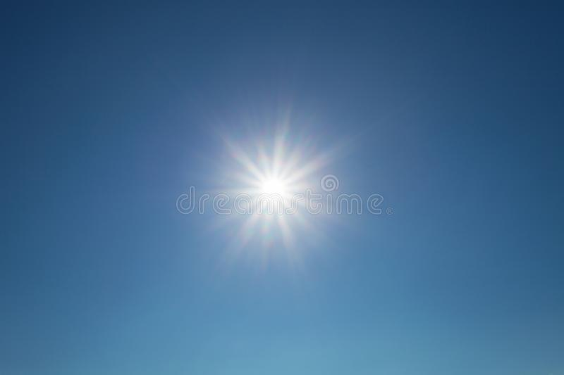 Shining sun blue sky with lens flare. royalty free stock image