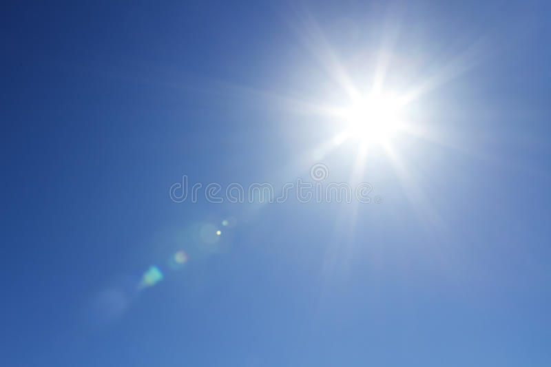Shining sun at clear sky with copy space royalty free stock photos