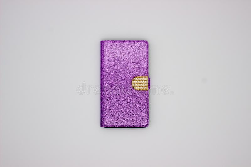 Shining Violet Case For A Smartphone With Sparkles And Golden Buckle. The Isolated Image On White Background.  stock image
