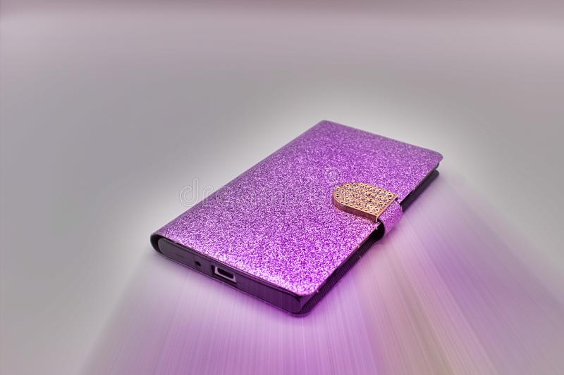 Shining Violet Case For A Smartphone With Sparkles And Golden Buckle. The Isolated Image On White Background.  stock photos