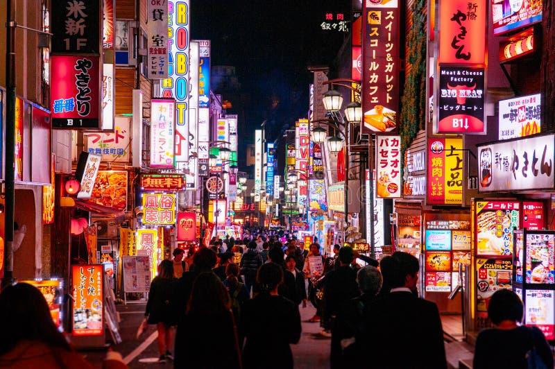 Shinjuku at night vibrant busy street night life with many lightbox signs - Tokyo. DEC 4, 2018 Tokyo, Japan - Shinjuku at night vibrant busy street night life stock photo