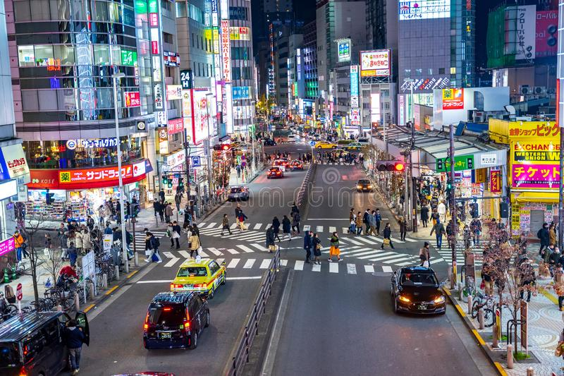 Shinjuku, Tokyo, Japan - December 24, 2018: View of street and cityscape at night with colorful advertisement billboard light in stock image
