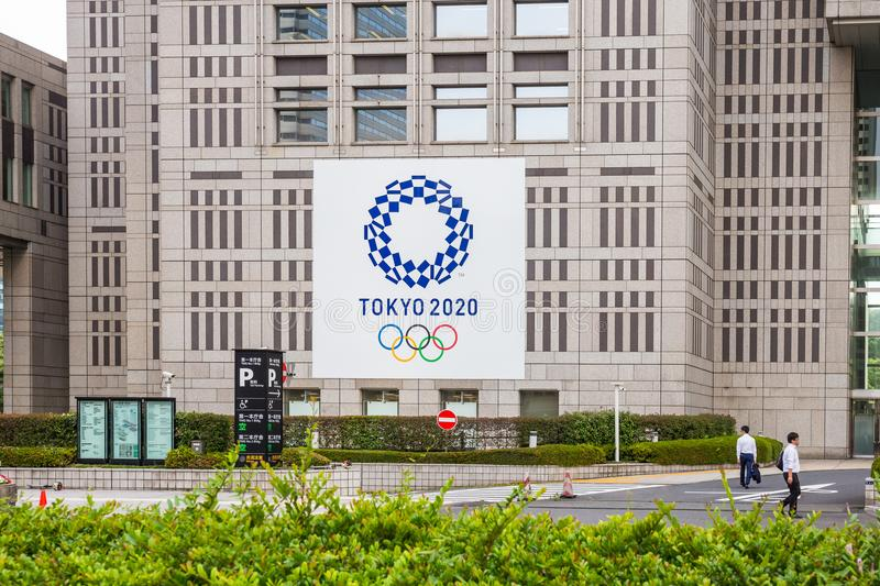 SHINJUKU TOKYO, JAPAN - June 8, 2018 : 2020 Tokyo Olympics logo on Metropolitan Government Building In the middle city is Landmark royalty free stock photography