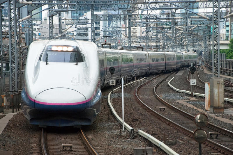 Shinkansen bullet train. Tokyo, Japan - May 20, 2012: Shinkansen bullet train at Tokyo main railway station in May 2012 Tokyo, Japan.The Shinkansen is the worlds royalty free stock photography