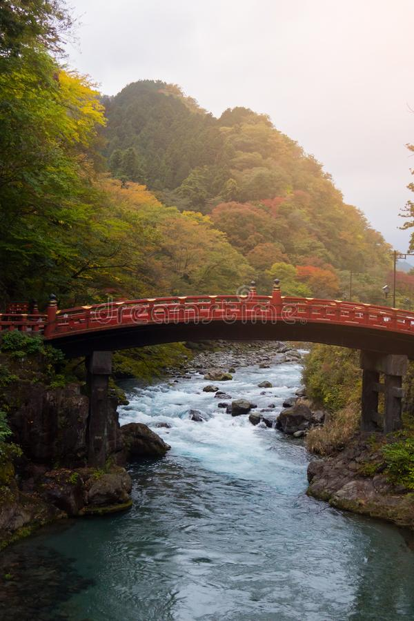 Shinkyo bridge with water stream in autumn forest at Nikko, Japan stock photography