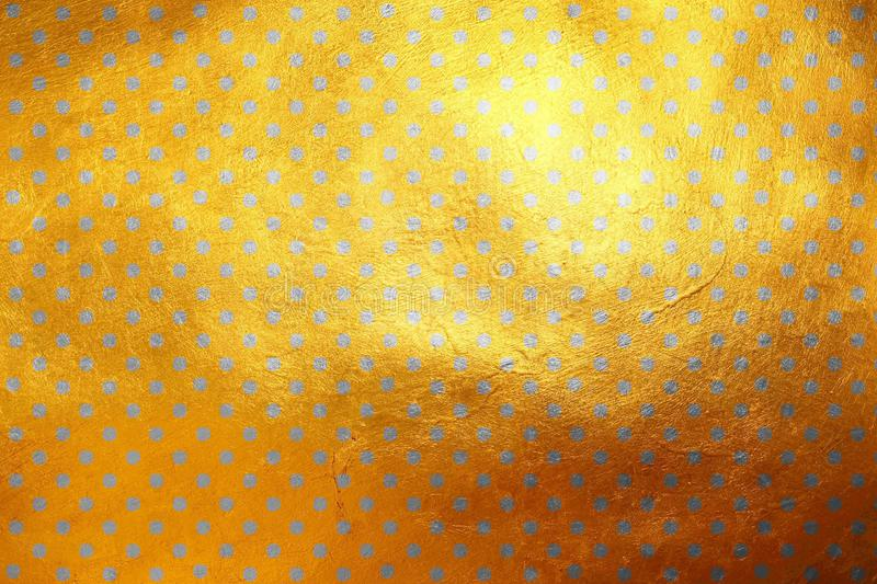 Shinning silver polka dots luxury creative digital abstract texture pattern on golden background. Design element stock photos