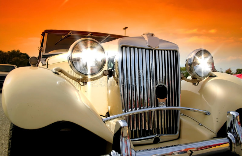 Shinny Classic Car. With colorful sky background stock images