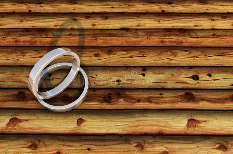 2 Shinny gli anelli d'argento sulla plancia di bambù fotografie stock