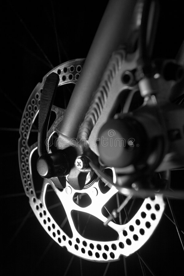 Shinny new disk brakes on pedal bike bicycle royalty free stock photos