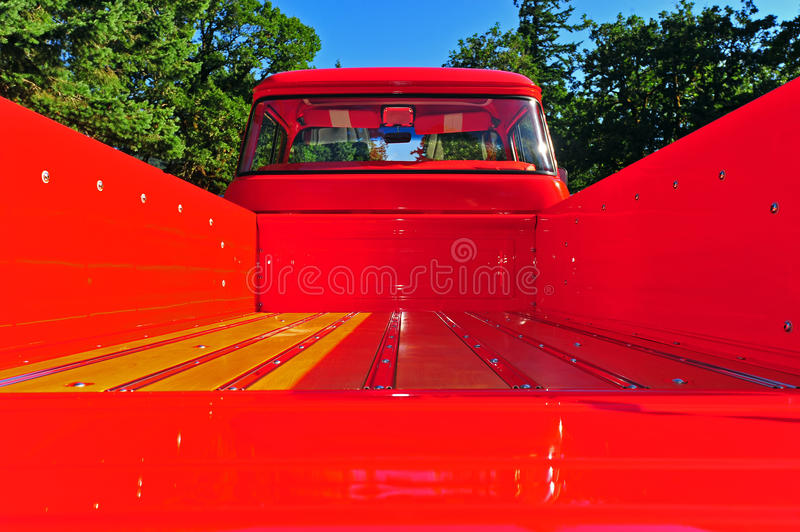 Shinny red and wood floor board truck bed stock image