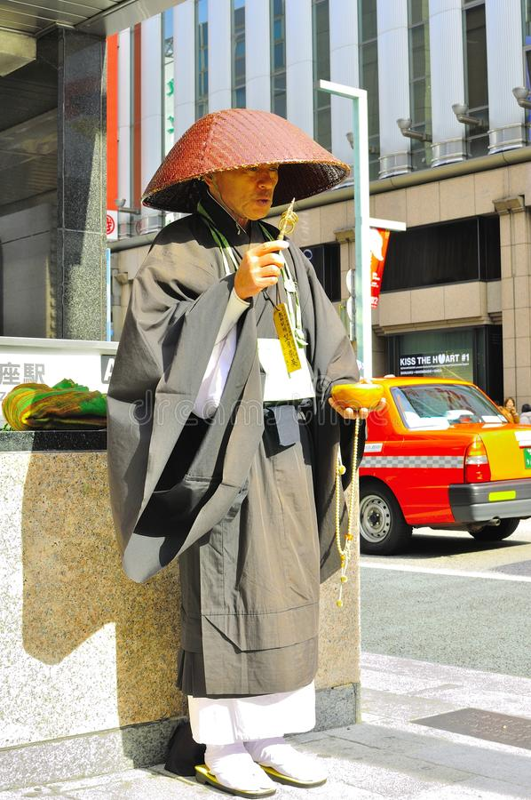 Download Shinto Monk Ringing Bell For Donation Editorial Stock Image - Image: 23364704