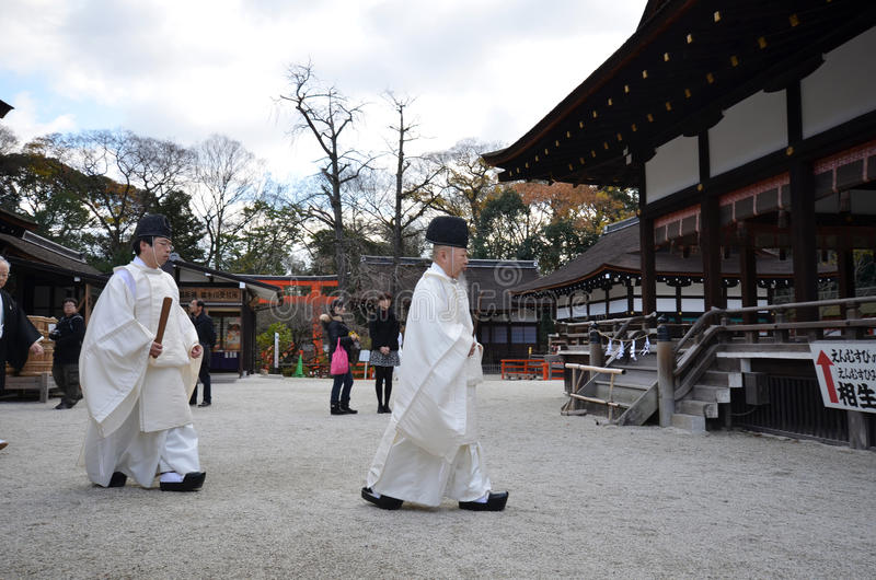 Shinto priests prepare for the praying ceremony in Shimogamo Shrine in Kyoto royalty free stock photography
