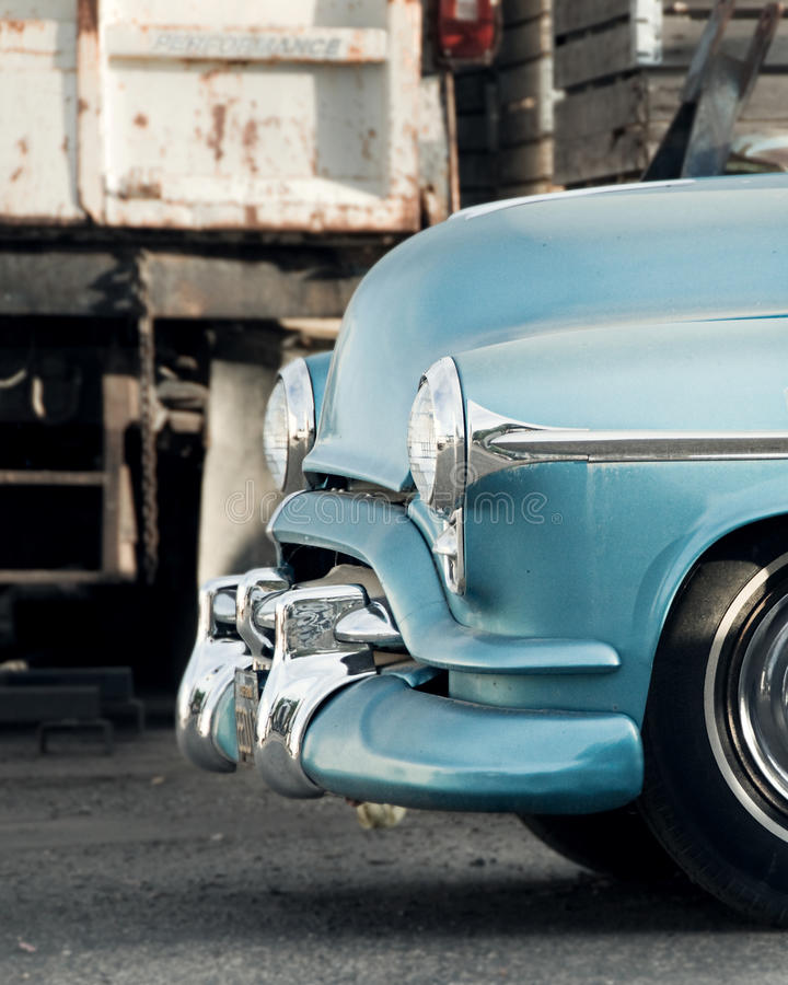 Shiny antique car. The front of a shiny antique blue car stock photography
