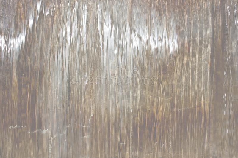 Shiny background of water falling. In shades of gray and gold royalty free stock image