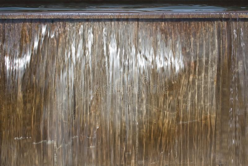 Shiny background of water falling. Shiny background abstract of water falling in shades of gray and gold royalty free stock photography