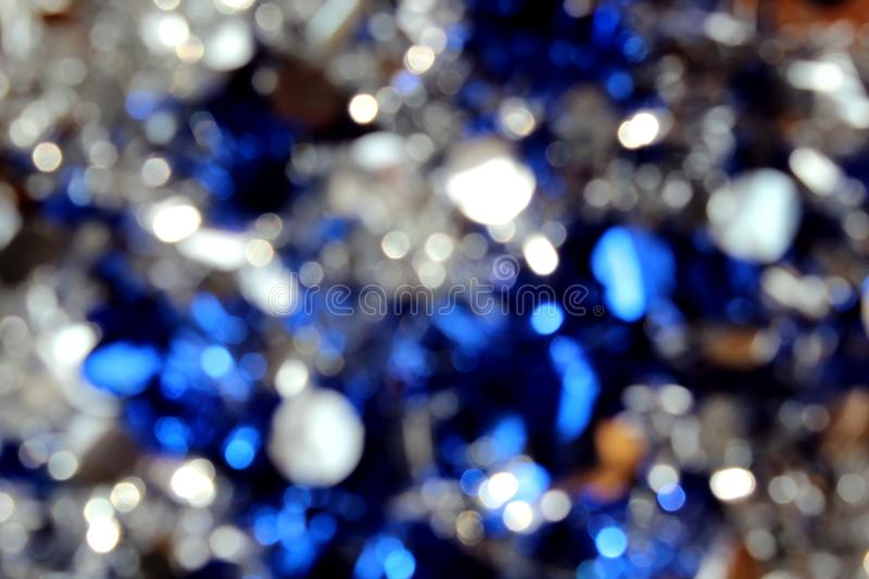 Shiny background white blue color mood christmas. Background, blue, glitter, light, abstract, bokeh, white, christmas, shiny, lights, decoration, texture stock photography