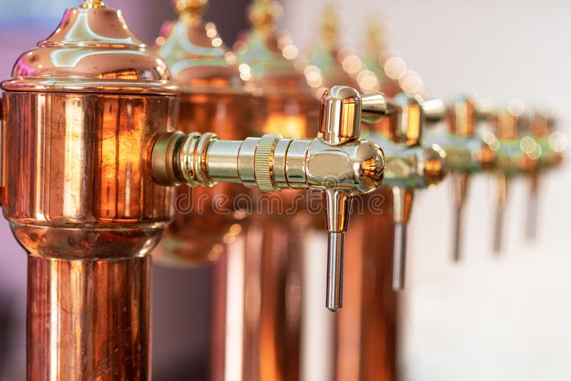 Shiny beer tap ready to serve cold beer at the bar. stock images