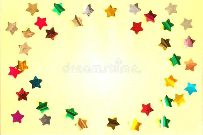 Shiny bright stars on yellow colored background stock photography