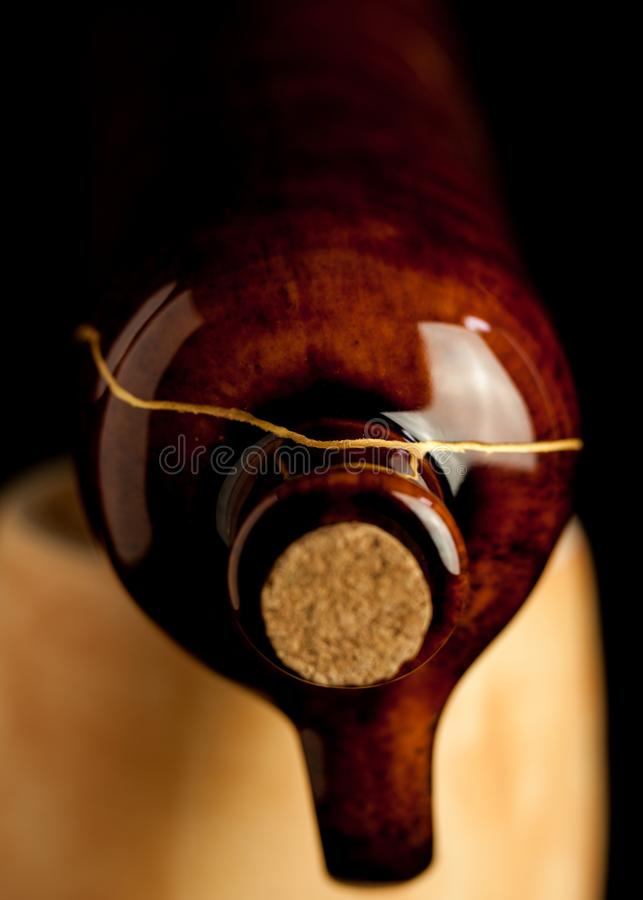 Shiny Brown Gold Kintsugi Wine Bottle stock photo