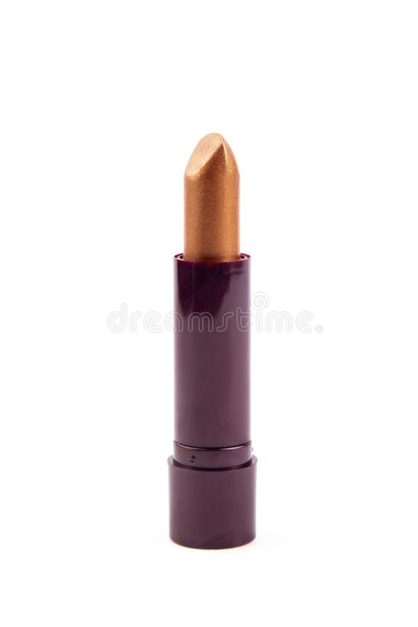 Shiny brown lipstick isolate. Lipstick of unusual color on white background royalty free stock photos