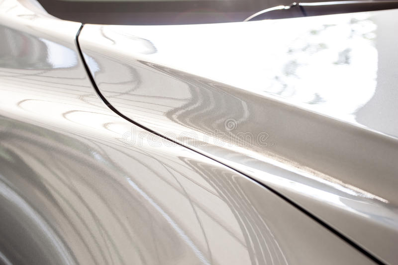 Shiny car body part. Grey color stock image