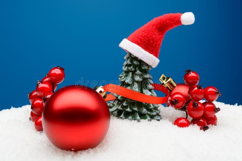 Shiny Christmas decor in snow royalty free stock photography
