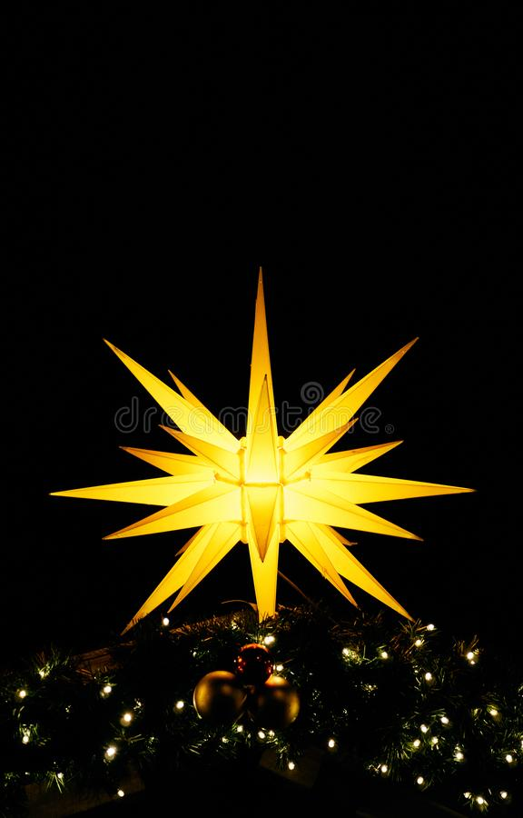 Shiny christmas star as a vertical background. Christmas decoration in the night stock photos
