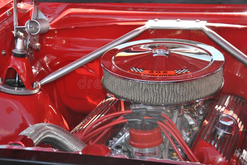 Shiny chromed engine of old red truck royalty free stock photography