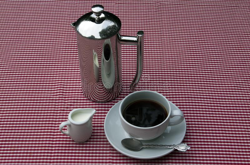 Shiny coffee pot and cup
